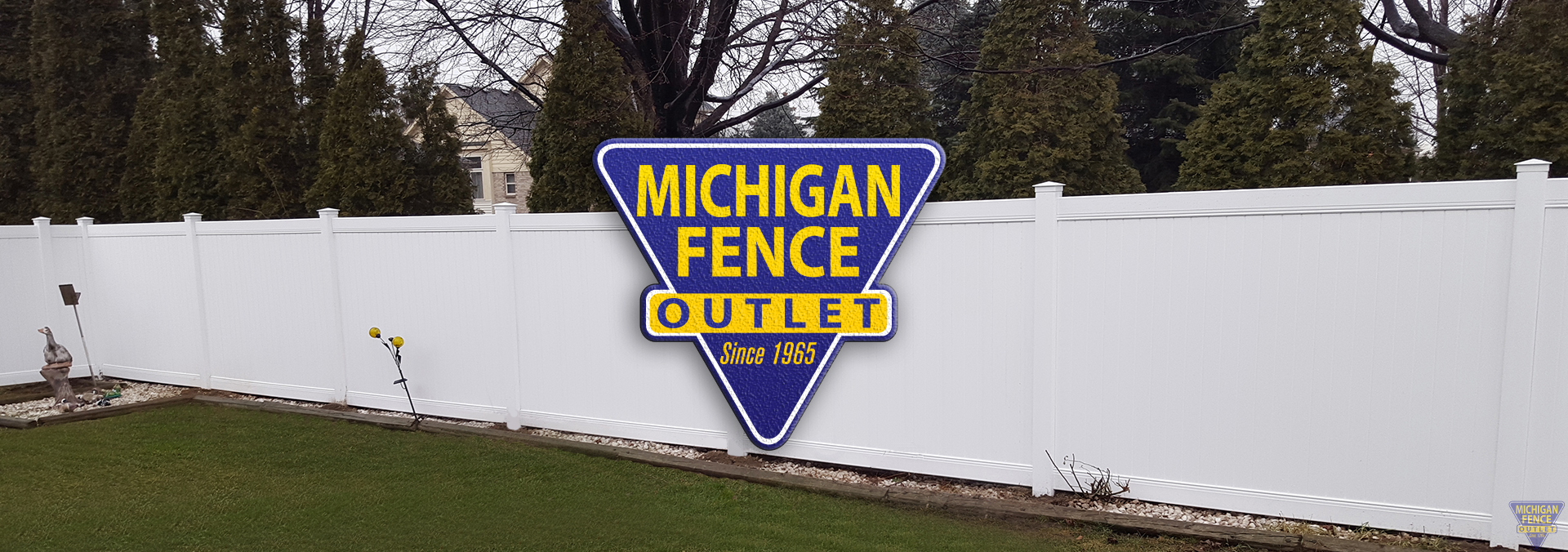 Michigan Fence Outlet Logo on a White Vinyl Fence